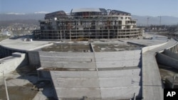 In this photo taken Thursday, Dec. 23, 2010 the construction of the Grand Ice Arena is seen in the Black Sea resort of Sochi, southern Russia. Sochi will host Winter Olympic games in 2014.