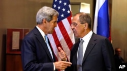 John Kerry and Sergei Lavrov shake hands after conducting a bilateral meeting. Tuesday, Sept. 24, 2013.