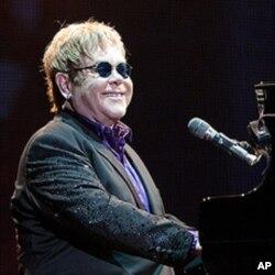 British singer Elton John performs in concert at the Ricardo Saprissa stadium in San Jose, Costa Rica, Feb. 3, 2012. T