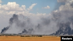 Smoke rises from Manbij city, Aleppo province, Syria, June 8, 2016. French special forces in northern Syria are assisting Kurdish-led militias in a drive to retake a pocket of territory west of the Euphrates River from the Islamic State terror group, according to French officials.