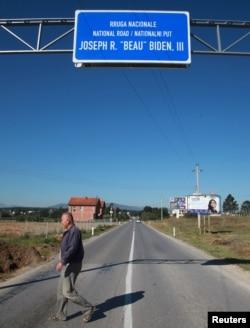A Kosovar crosses the road ahead of U.S. Vice President Joe Biden's visit, in the village of Sojeve, Aug. 15, 2016.
