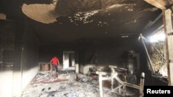 A man walks inside the U.S. consulate in Benghazi, which was attacked September 11, 2012.