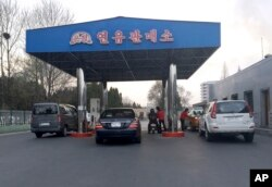 FILE - Cars line up at the pumps at a gas station in Pyongyang, North Korea, April 1, 2016.. Higher prices were a problem in early 2016, but recently an apparent gas shortage is causing the pain at the pump.