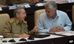 Cuba's President Raul Castro, left, talks with Vice President Miguel Diaz Canel during the opening of the National Assembly session in Havana, Cuba, July 8, 2016.