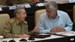 FILE - Cuba's President Raul Castro, left, talks with First Vice President Miguel Diaz-Canel during the opening of the National Assembly session in Havana, Cuba, July 8, 2016.