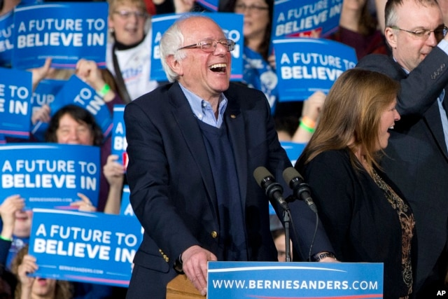 Democratic presidential candidate Sen. Bernie Sanders of Vermont laughs as he arrives with his wife, Jane Sanders, and his son Levi Sanders to a primary night rally in Essex Junction, Vt., March 1, 2016.