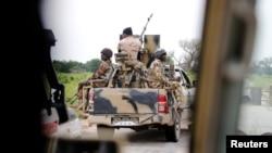 FILE - A Nigerian army convoy vehicle with an anti-aircraft gun drives toward Bama, Borno State, Nigeria, August 31, 2016.