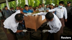 Family members of victims from a military plane crash prepare for a funeral ceremony in Dawei, Myanmar, June 9, 2017.