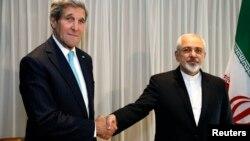 14일 스위스 제네바에서 존 케리 미 국무장관(왼쪽)이 자바드 자리프 이란 외무장관과 회담했다.