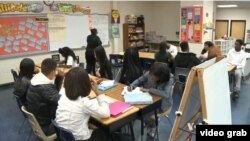 Students attend a financial literacy class at Charles H. Flowers High School in the state of Maryland.
