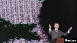 Syria's President Bashar al-Assad speaks at the Opera House in Damascus January 6, 2013, in this handout photograph released by Syria's national news agency SANA.
