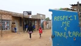 Bright messages on the toilet's walls are not enough to prevent vandalism in Diepsloot, South Africa, December 2012. (VOA/S. Honorine)