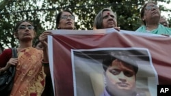 Bangladeshi social activists hold a banner displaying a portrait of blogger and author Ananta Bijoy Das during a protest against his killing, in Dhaka, Bangladesh, May 12, 2015.