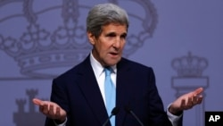 U.S. Secretary of State John Kerry answers a question during a joint news conference with Spain's Foreign Minister Jose Manuel Garcia Margallo at the Santa Cruz palace, Spain's Foreign Affairs Ministry, in Madrid, Spain, Monday, Oct. 19, 2015.