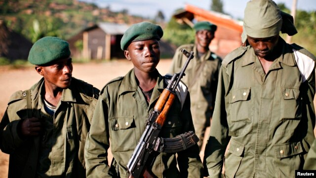 FILE - Child soldiers, possibly Rwandan, are seen at Kanyabayonga in eastern Congo.