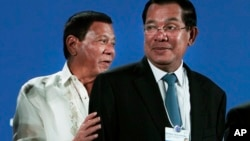 Philippine President Rodrigo Duterte, left, and Cambodian Prime Minister Hun Sen, right, attend an opening the World Economic Forum on ASEAN, in Phnom Penh, Cambodia, Thursday, May 11, 2017. Some 700 people from 40 countries in the region has been attended this week the World Economic Forum on ASEAN that was held by impoverished Cambodia. (AP Photo/Heng Sinith)