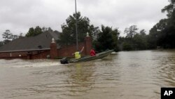 A rescue boat enters a flooded subdivision as floodwaters from Tropical Storm Harvey rise Aug. 28, 2017, in Spring, Texas.