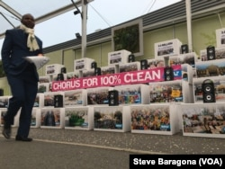 Voice mails from around the world left for negotiators at the Paris climate talks play at a display by the international environmental group Avaaz, Dec. 10, 2015.