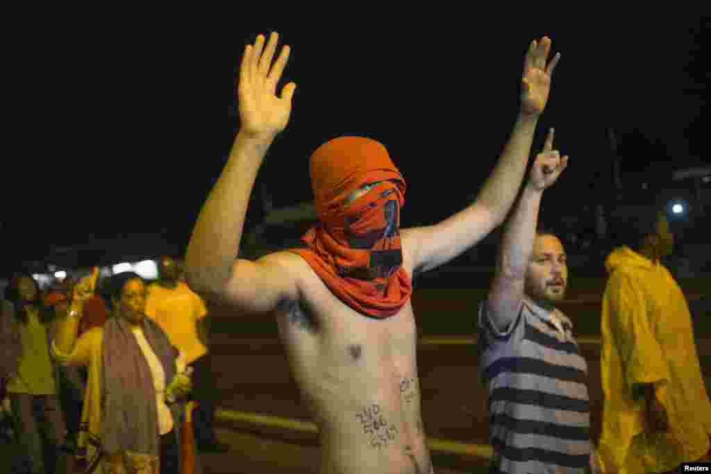 "Demonstrators shout ""Hands up, don't shoot,"" in Ferguson, Missouri, Aug. 20, 2014."