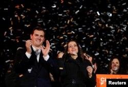 Catalan Ciudadanos leader Ines Arrimadas, center, smiles next to Ciudadanos national leader Albert Rivera at a Ciudadanos rally after results were announced in Catalonia's regional elections in Barcelona, Spain, Dec. 21, 2017.