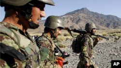 Afghan soldiers carry their weapons during a joint military patrol with US soldiers from Alpha Co, 2nd Battalion 35th Infantry, Task Force 'Cacti' in Walay valley, near the Afghanistan-Pakistan border in Kunar province, October 2, 2011.