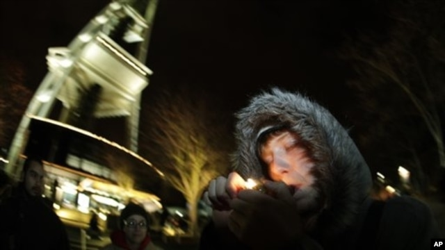 Man smokes marijuana just after midnight at the Space Needle in Seattle, Washington, Dec. 6, 2012.