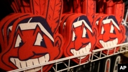 Foam images of the MLB baseball Cleveland Indians' mascot Chief Wahoo are displayed for sale at the Indians' team shop in Cleveland, Jan. 29, 2018.