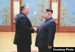 FILE - A U.S. government handout photo shows then-Central Intelligence (CIA) Director Mike Pompeo meeting with North Korean leader Kim Jong Un in Pyongyang, North Korea.