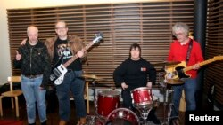 Life is good for senior citizens in Finland. Here, members of the Finnish punk band Pertti Kurikan Nimipaivat, all nearing their 60s, continue to rock on. (FILE PHOTO/March 2015.)