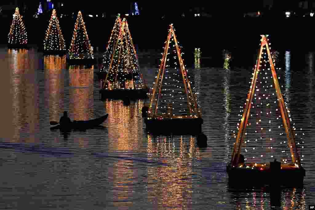 A kayaker paddles among holiday lights, Dec. 16, 2020, in Long Beach, California.