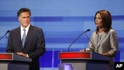 图为共和党参选人、前麻萨诸塞州州长罗姆尼和女众议员巴赫曼8月11日进行辩论