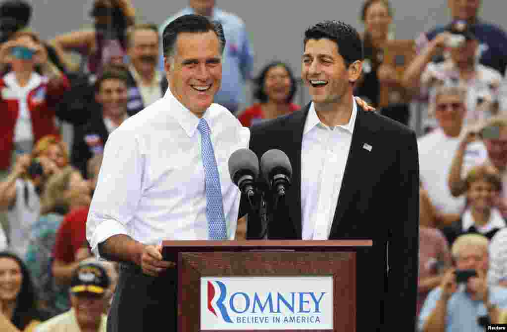 Republican U.S. Presidential candidate Mitt Romney (L) introduces Congressman Paul Ryan (R-WI) as his vice-presidential running mate during a campaign event at the retired battleship USS Wisconsin in Norfolk, Virginia, August 11, 2012.