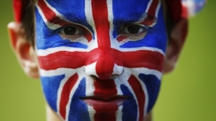 Spectator Nat Aaronson, whose face is painted like a Union flag, poses for a portrait on the Box Hill circuit of the men's cycling road race at the London 2012 Olympic Games in London July 28, 2012. 012 Olympic Games in London July 28, 2012. REUTERS/Mark