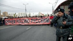 About 7,000 Russian nationalists marched, waving Czarist flags, and chanting such anti-immigrant slogans as 'Migrants Today, Occupiers Tomorrow,' in Moscow, November 4, 2011.