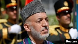 Afghan President Hamid Karzai attends an event to commemorate Afghanistan's 95th anniversary of independence in Kabul, Aug. 19, 2014.