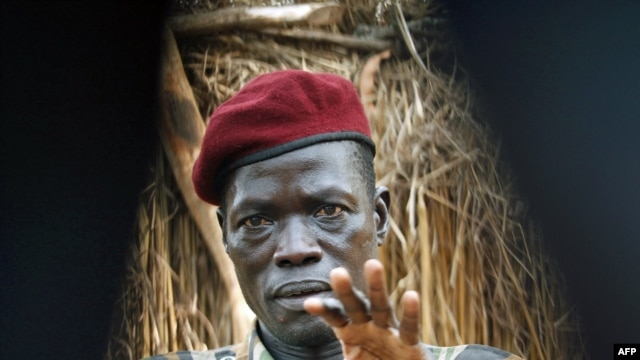 Lord's Resistance Army (LRA) commander Caesar Acellam gestures as he talks to the media after he was captured by Ugandan soldiers tracking  LRA fugitive leaders at a forest bordering the Central African Republic and the Democratic Republic of Congo, in Dj