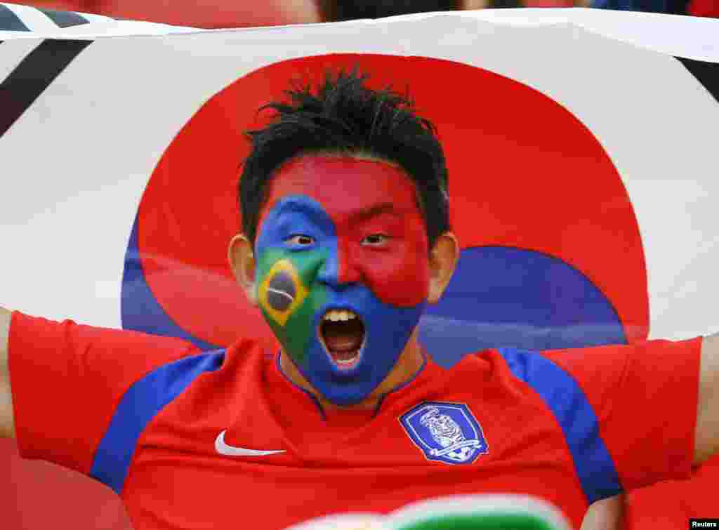 A fan of South Korea shouts before their match against Algeria at the Beira Rio stadium in Porto Alegre, June 22, 2014.