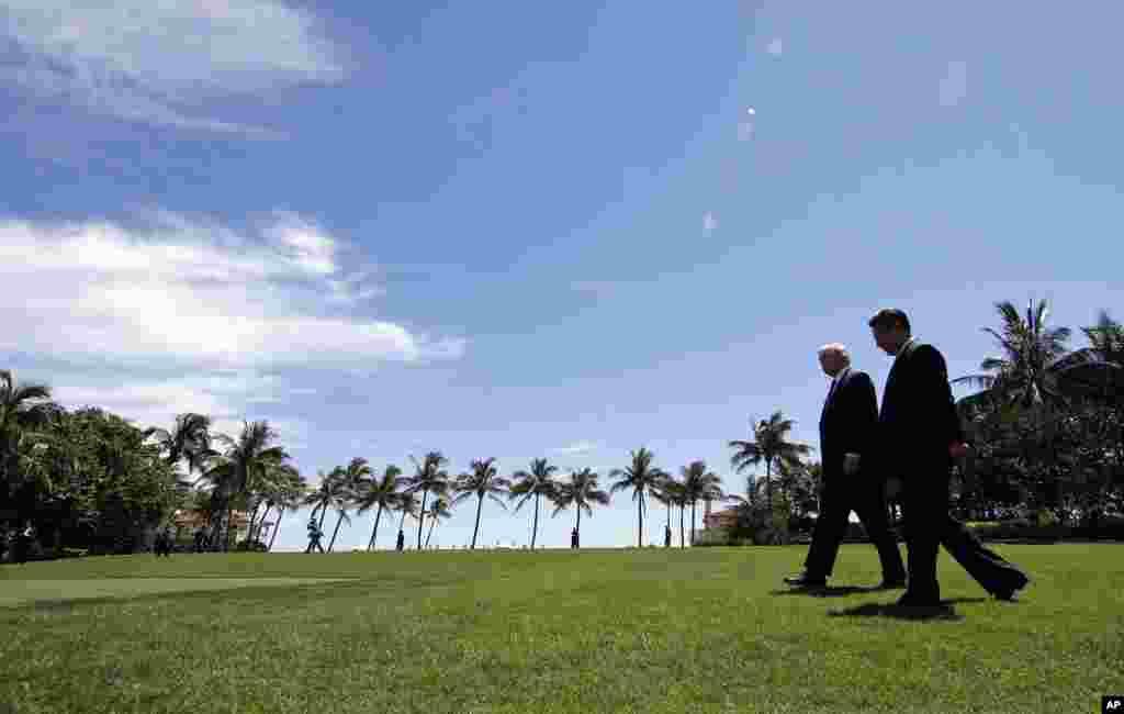 美国总统川普和中国主席习近平在海湖庄园会晤后散步(2017年4月7日)