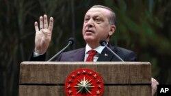 FILE - Turkey's President Recep Tayyip Erdogan addresses a group of farmers, in Ankara, Turkey, Monday, Nov. 14, 2016. Sunday, Erdogan said Turkey doesn't need to join the European Union.