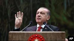 FILE - Turkey's President Recep Tayyip Erdogan addresses a group of farmers, in Ankara, Turkey, Monday, Nov. 14, 2016.