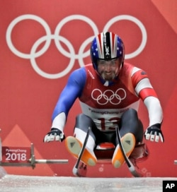 Chris Mazdzer of United States starts his first men's luge run at the 2018 Winter Olympics in Pyeongchang, South Korea, Saturday, Feb. 10, 2018. (AP Photo/Wong Maye-E)