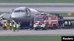 Members of emergency services and investigators work at the scene of an incident involving an Aeroflot Sukhoi Superjet 100 passenger plane at Moscow's Sheremetyevo airport, Russia, May 6, 2019.