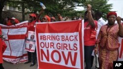 "Scores of protesters marched chanting ""Bring Back Our Girls"" kidnapped by Boko Haram."