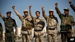 Houthi Shiite Yemenis wearing army uniforms chant slogans during a rally to show support for their comrades in Sanaa, Yemen, Feb. 4, 2015.