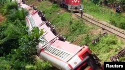 FILE - A derailed train is seen in Eseka, Cameroon, Oct. 21, 2016.