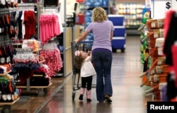 FILE - A woman shops with her daughter at a Walmart Supercenter in Rogers, Arkansas.