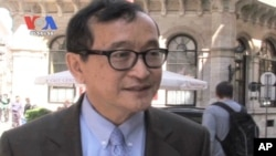 Sam Rainsy remains in exile, facing a raft of criminal charges he says are politically motivated.