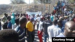 People milling around one of the border posts today following a protest over an import ban on basic commodities.