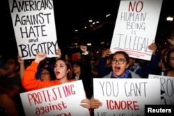 Demonstrators protest outside of City Hall following the election of Republican Donald Trump as President of the United States in downtown Los Angeles, California, Nov. 10, 2016.