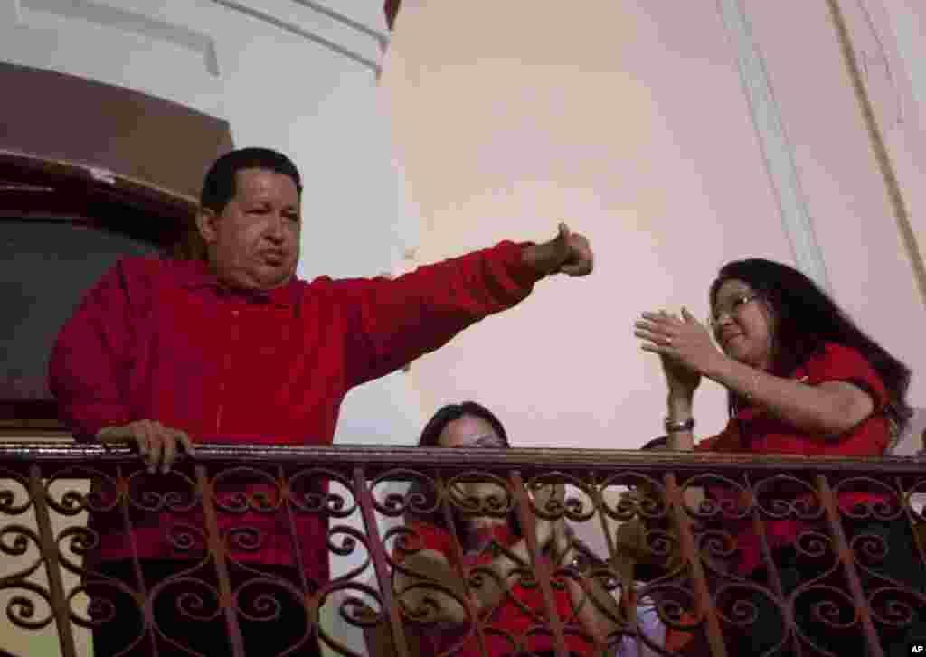 Venezuela's President Hugo Chavez greets his supporters from the Miraflores presidential palace balcony in Caracas, Venezuela.